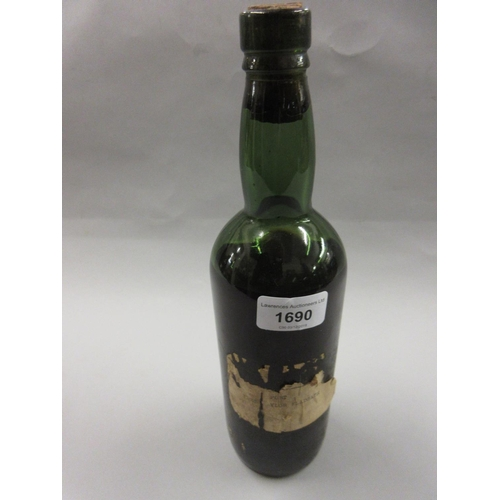 1690 - One bottle Taylor Fladgate, 1935 vintage port (label and seal at fault)...