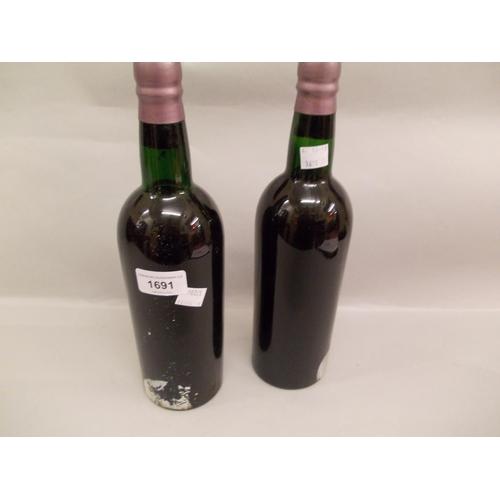 1691 - Two bottles Martinez, 1963 vintage port bottled by John Harvey (minus labels)...