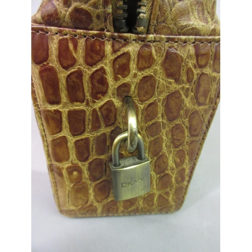 17 - D.K.N.Y. leather simulated crocodile handbag, with dust cover...