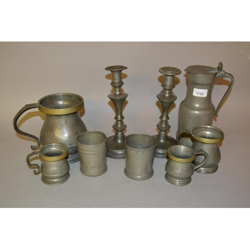 1782 - Antique pewter tappit hen, pair of pewter candlesticks together with a quantity of various pewter me...