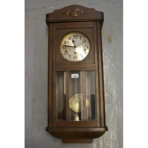 1850 - 1920's Oak three train wall clock...