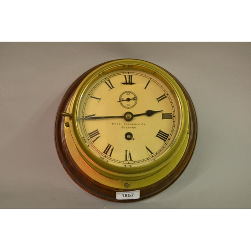 1857 - Early 20th Century ships brass bulkhead clock with painted dial, having Roman numerals, subsidiary s...