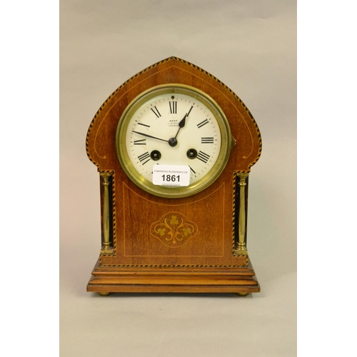1861 - Edwardian mahogany and inlaid arch top mantel clock, the enamel dial with Roman numerals, inscribed ...