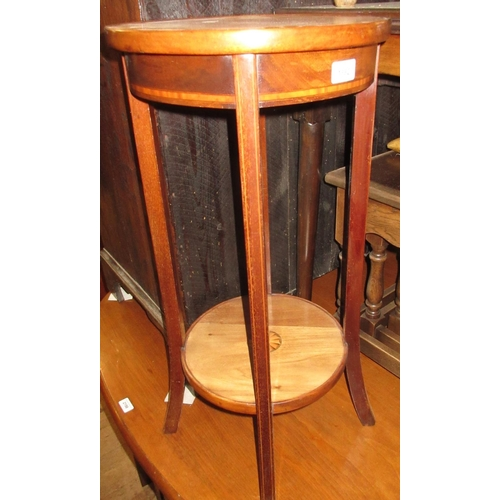 1882 - Edwardian mahogany circular two tier jardiniere stand, a wrought iron three tier cake stand with thr...