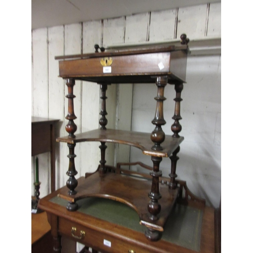 1887 - Victorian walnut and inlaid Davenport with a brass rail back, hinged sloping top and open shelf base...