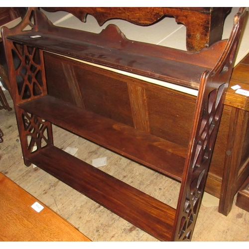 1888 - Reproduction mahogany three shelf wall bracket with pierced fretwork sides...