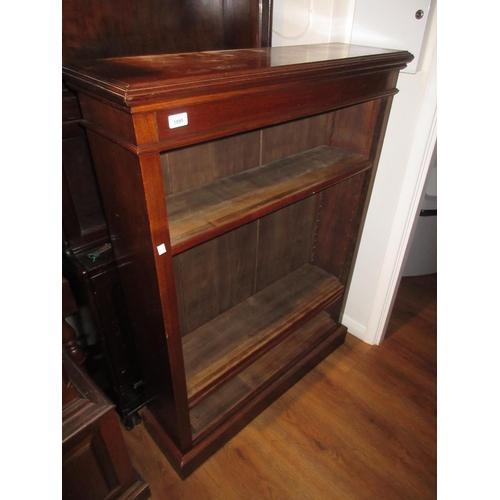 1895 - Mahogany four shelf dwarf open bookcase with plinth base...