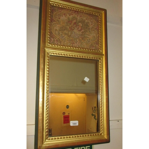 1904 - Small rectangular gilt framed wall mirror, the upper panel inset with a machine woven tapestry...