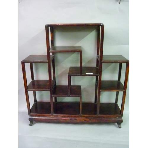 1906 - Small oriental hardwood multi shelf display unit, a reproduction three shelf wall bracket and a simi...