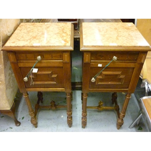 1908 - Pair of late 19th or early 20th Century Continental walnut bedside cabinets, each with an inset marb...