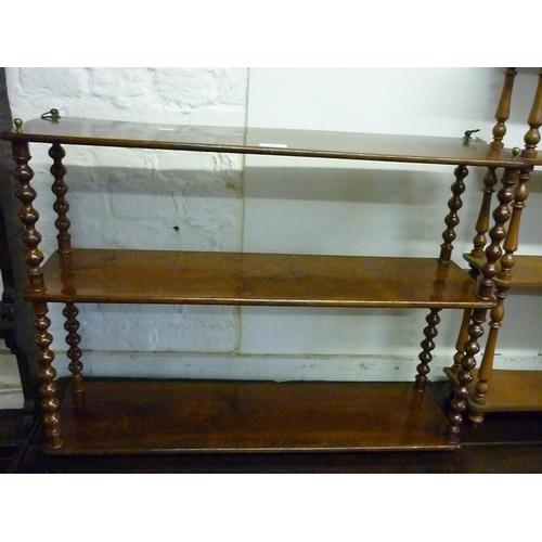1909 - 19th Century mahogany three tier wall bracket with bobbin turned uprights...