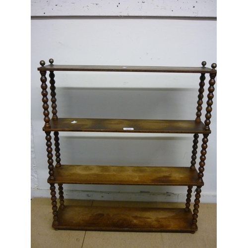 1910 - Stained beechwood four tier wall bracket with bobbin turned uprights...