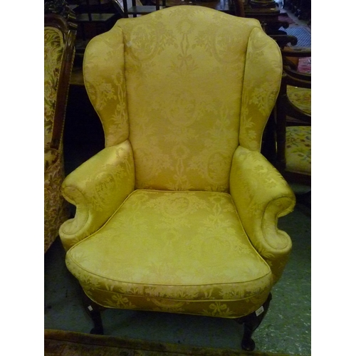 1918 - Early 20th Century gold damask upholstered wing armchair in 18th Century style on carved cabriole su...