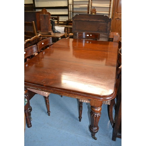 1924 - Victorian mahogany pull-out extending dining table, the rectangular moulded top raised on four turne...