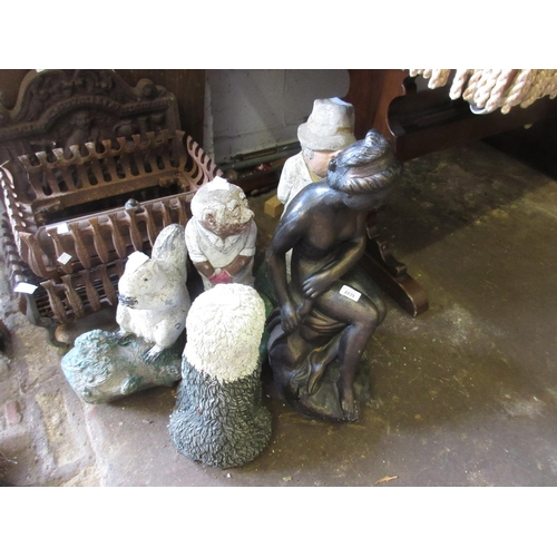 2239 - Composite nude female garden figure, together with a cast concrete garden figure...