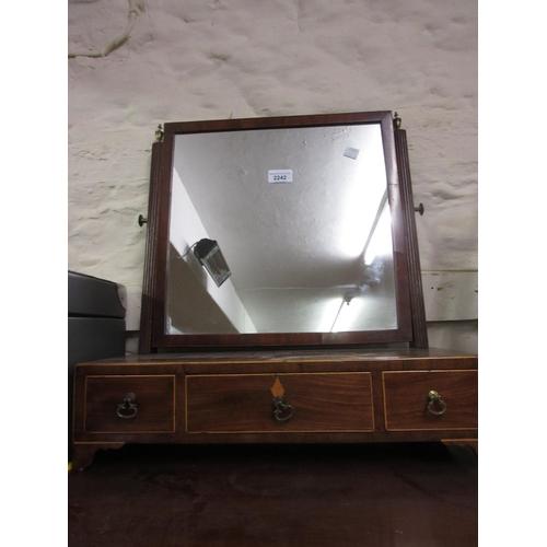 2242 - George III mahogany swing frame box toilet mirror with a three drawer base...