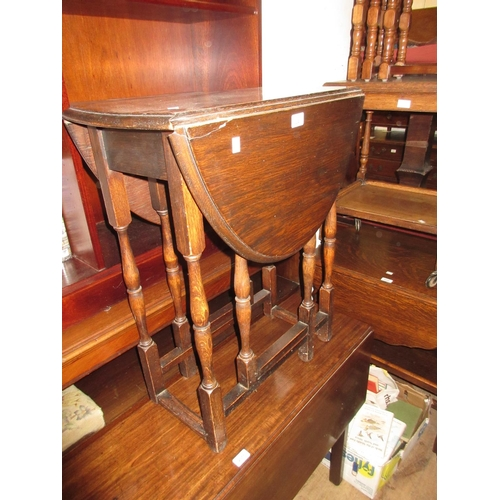 2243 - Small oak oval gate leg table and an octagonal bevelled edge wall mirror...