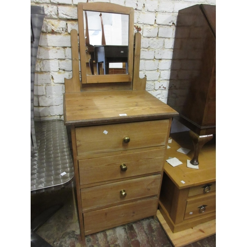 2245 - Narrow 19th Century stripped pine dressing chest with a mirrored back above four drawers...