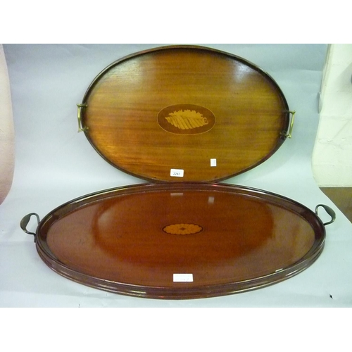 2247 - Two Edwardian mahogany oval two handled trays having central inlaid decoration and brass handles...