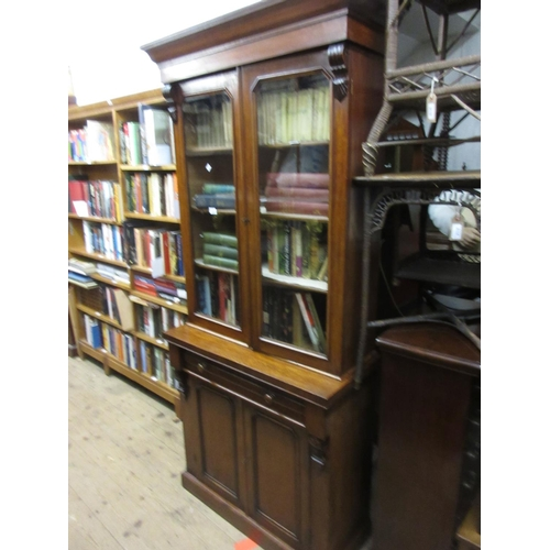 2248 - 19th Century mahogany bookcase having moulded cornice above two glazed doors enclosing three adjusta...