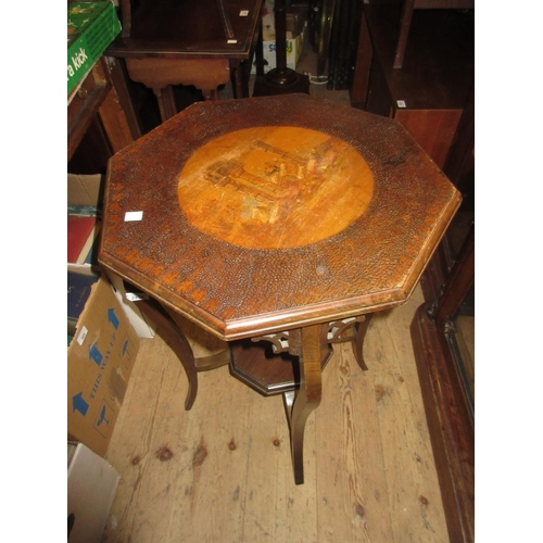 2250 - 20th Century occasional table having pokerwork top depicting oriental figures before ruins with dist...