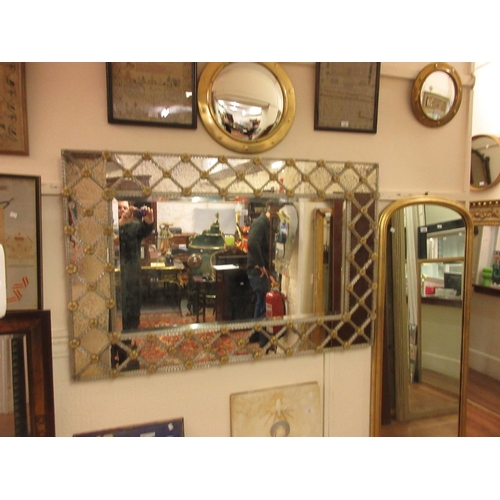 2254 - Venetian rectangular hanging wall mirror with centre bevelled plate bordered by trellis work and flo...