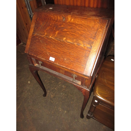 2257 - Small early 20th Century oak bureau with a fall front above a single drawer on cabriole supports...