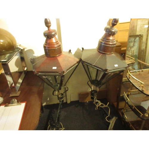 2261 - Pair of large hexagonal copper street lanterns, each mounted on a cast iron wall bracket and adapted...
