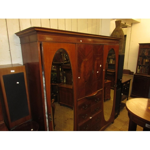 2263 - Edwardian mahogany and satinwood crossbanded triple section wardrobe, the moulded cornice above a pa...