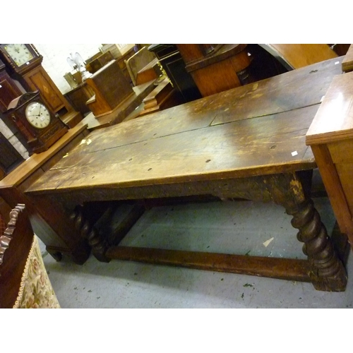 2269 - Oak refectory dining table, the plank top above a carved frieze raised on four barley twist supports...