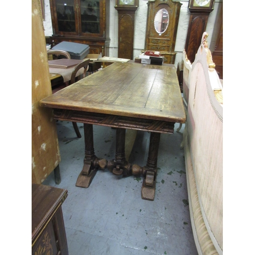 2270 - Good quality reproduction oak refectory dining table, the plank top with carved frieze raised on tri...