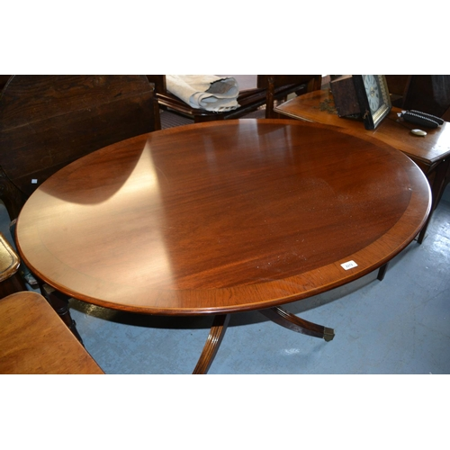 2272 - William Tillman, oval reproduction mahogany crossbanded and line inlaid tilt top dining table on tur...