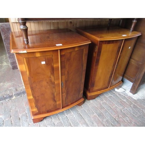2279 - Pair of reproduction yew wood two door bow fronted bedside cabinets together with a reproduction yew...