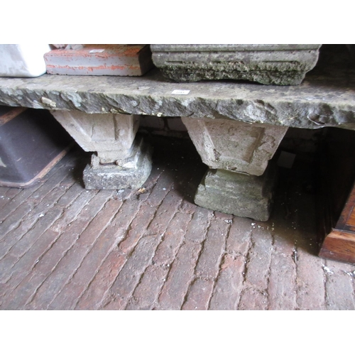 2281 - Small re-constituted stone garden bench with square baluster supports...
