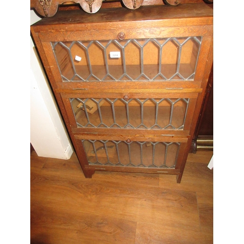 2284 - Small oak and leaded glass three door bookcase...