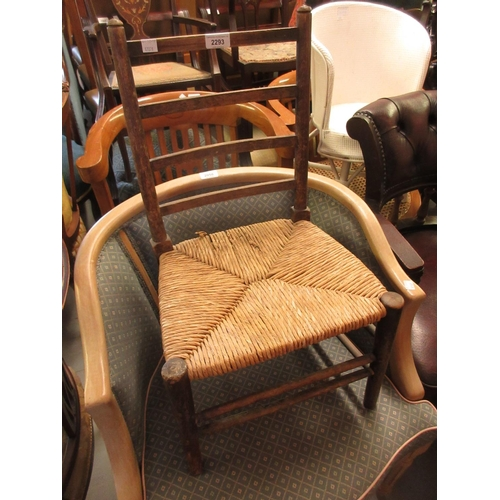 2293 - Child's beechwood ladder back chair with rush seat, together with a child's white painted tub chair...