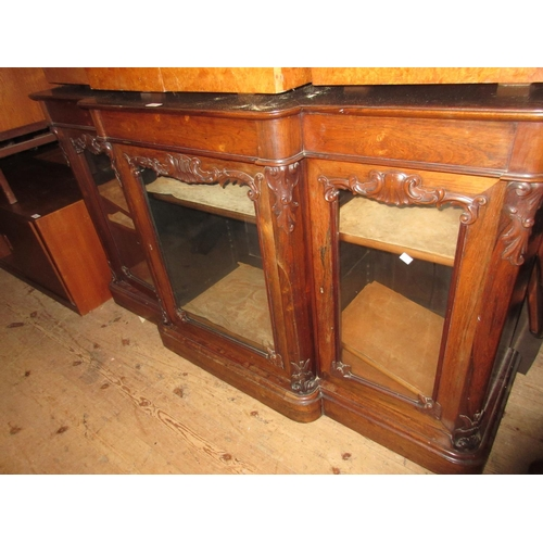 2305 - Victorian rosewood breakfront side cabinet with three glazed doors on a plinth base...
