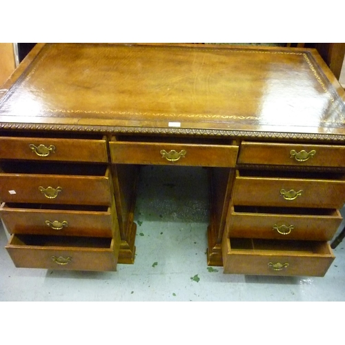 2307 - Early 20th Century burr walnut twin pedestal desk in early 18th Century style, having brown leather ...