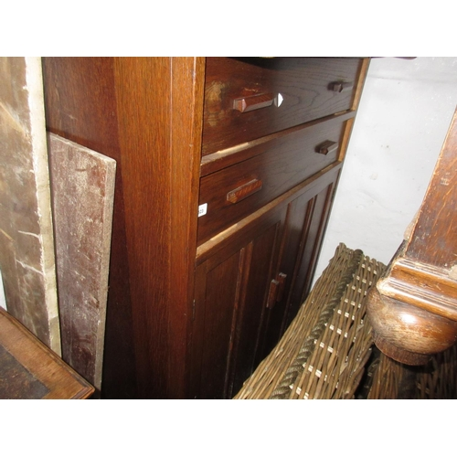 2323 - 20th Century oak side cabinet having two long drawers with wooden handles above two panel doors toge...