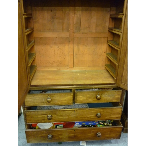 2324 - 19th Century Irish mahogany linen press, the shaped top above two panelled doors with two short and ...