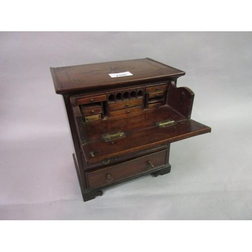 2360 - 19th Century miniature mahogany and inlaid chest with a fitted secretaire drawer above two short and...