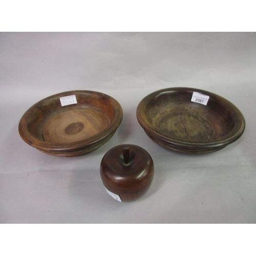 2367 - Two antique treenware coasters, one with a replacement base insert, together with a small treenware ...