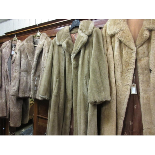 25 - Four various fur and simulated fur ladies jackets and coats, together with a quantity of fur hats...
