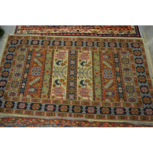 3 - Indo Persian rug with a banded design in pastel shades, together with a small Belouch rug...