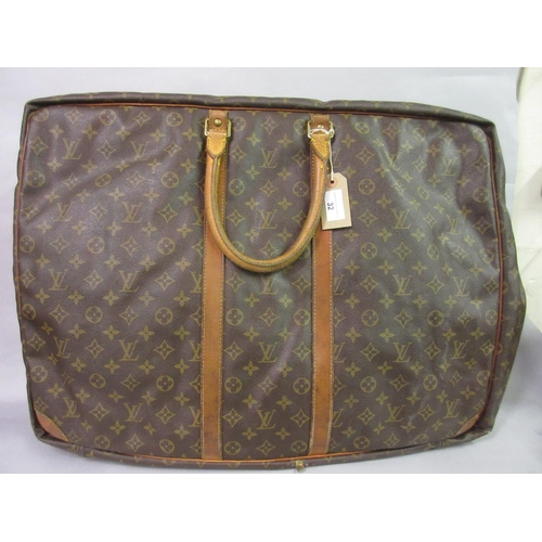 32 - Louis Vuitton holdall with leather handles (at fault)...