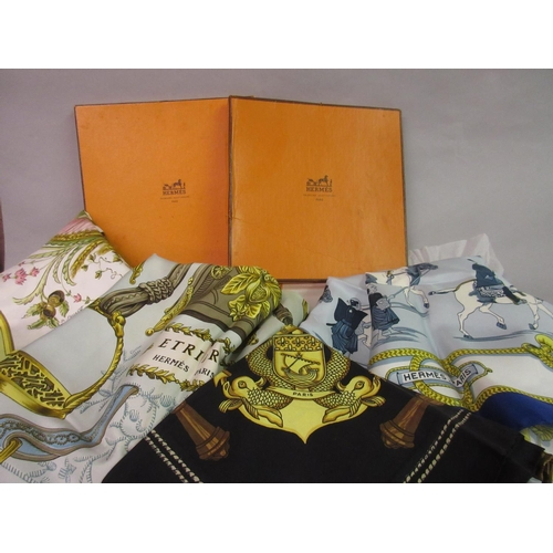 37 - Two ladies Hermes silk head scarves with original boxes and two other ladies Hermes silk head scarve...
