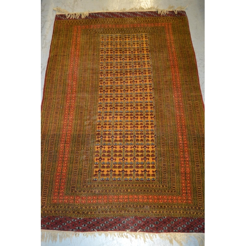4 - Pakistan rug of Turkoman design on a rust ground, 38ins x 58ins...