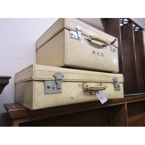 44 - Two early 20th Century white leather suitcases bearing owners initials...