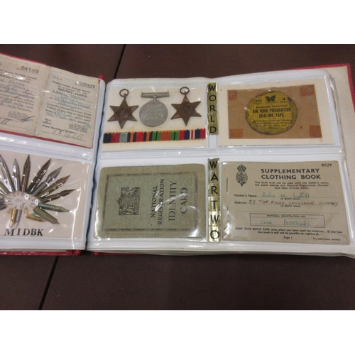 46 - Album containing a quantity of World War I and II memorabilia and ephemera including medals, togethe...