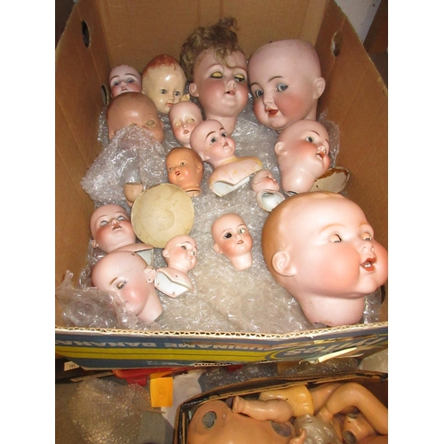57 - Quantity of various bisque dolls heads, including large Simon and Halbig head with sleeping and side...